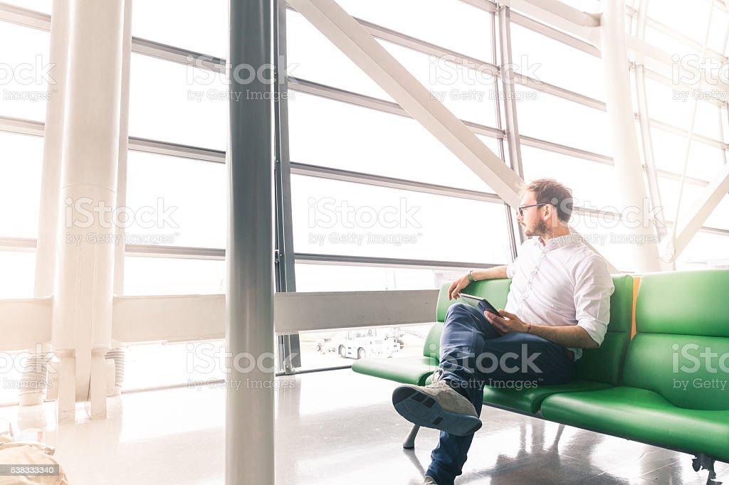 man waiting his flight stock photo