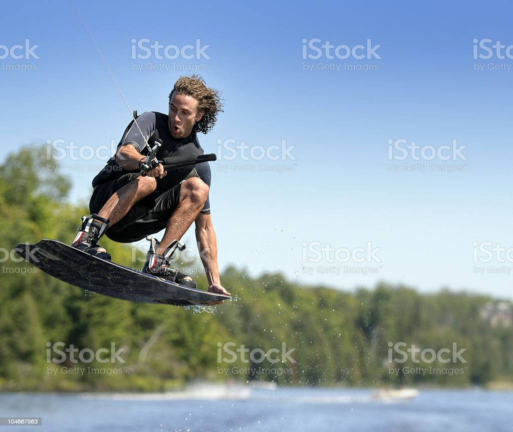 Man wakeboard on a bright sunny day stock photo