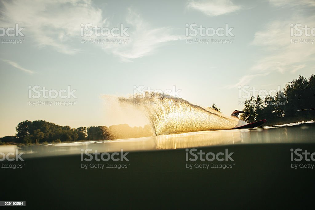 Man wakeboarding on a lake stock photo
