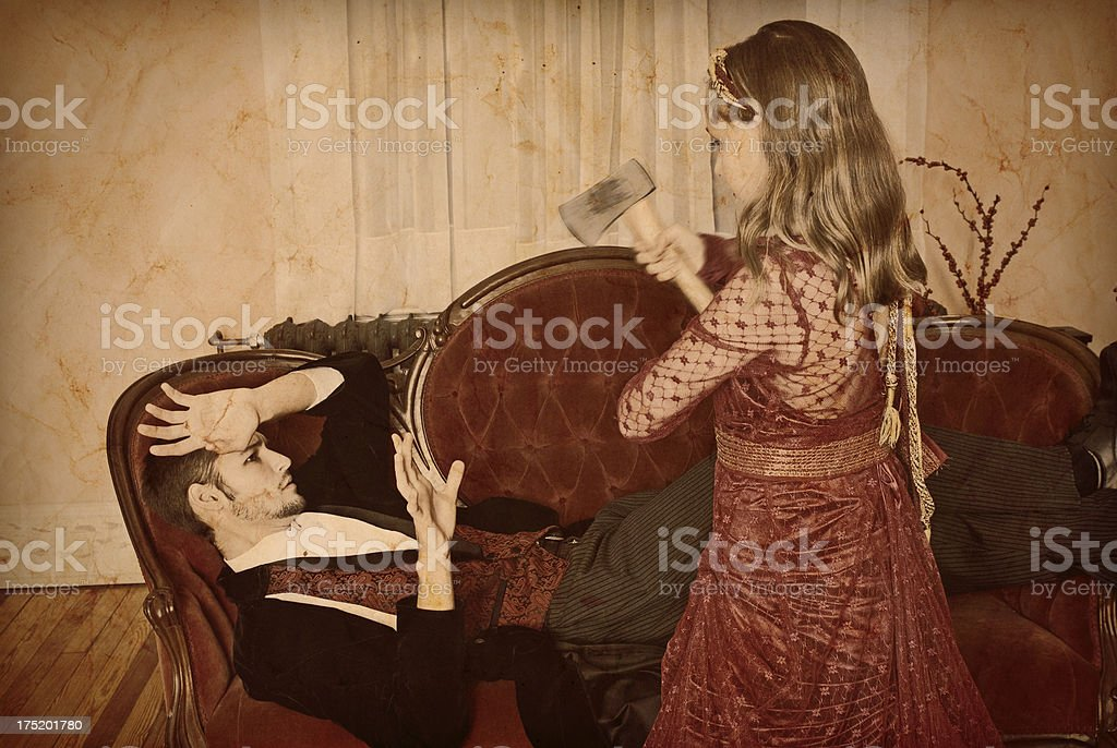 Man Wakes To Find Child Swinging Hatchet At Him royalty-free stock photo