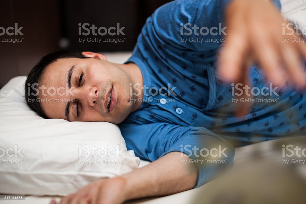 Man waking up stock photo