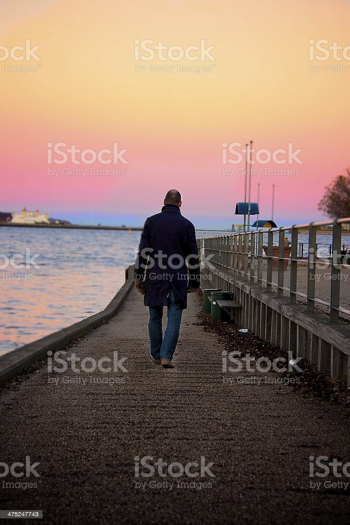 Man walk away stock photo