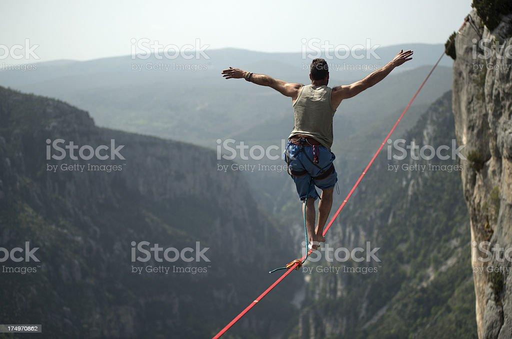 Man walking a slackline in the Gorges du Verdon, France stock photo