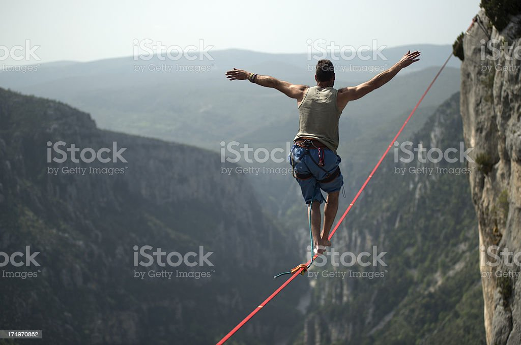 Man walking a slackline over Verdon Gorges, France stock photo