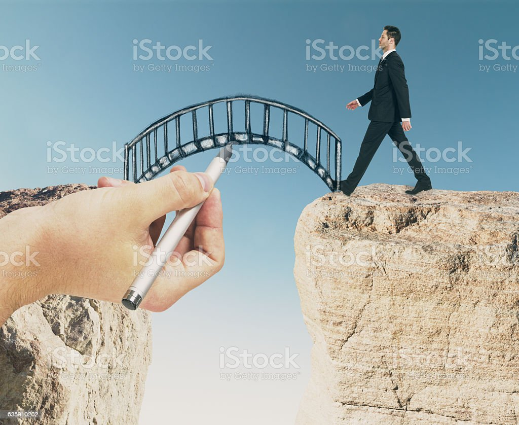 Man walking across bridge stock photo