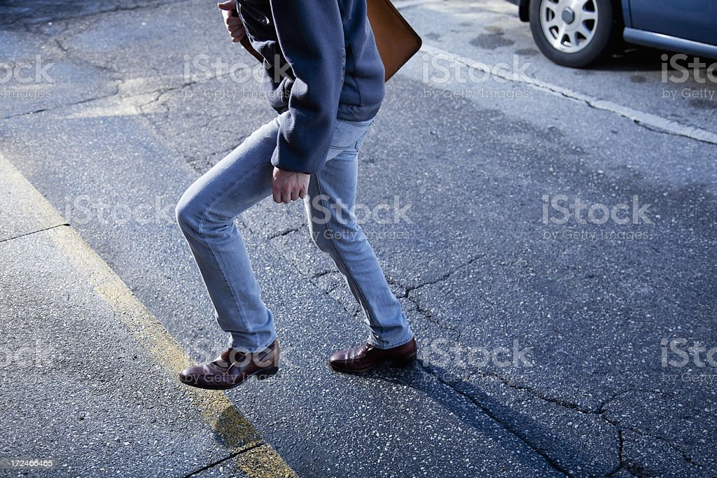 Man walking across street royalty-free stock photo