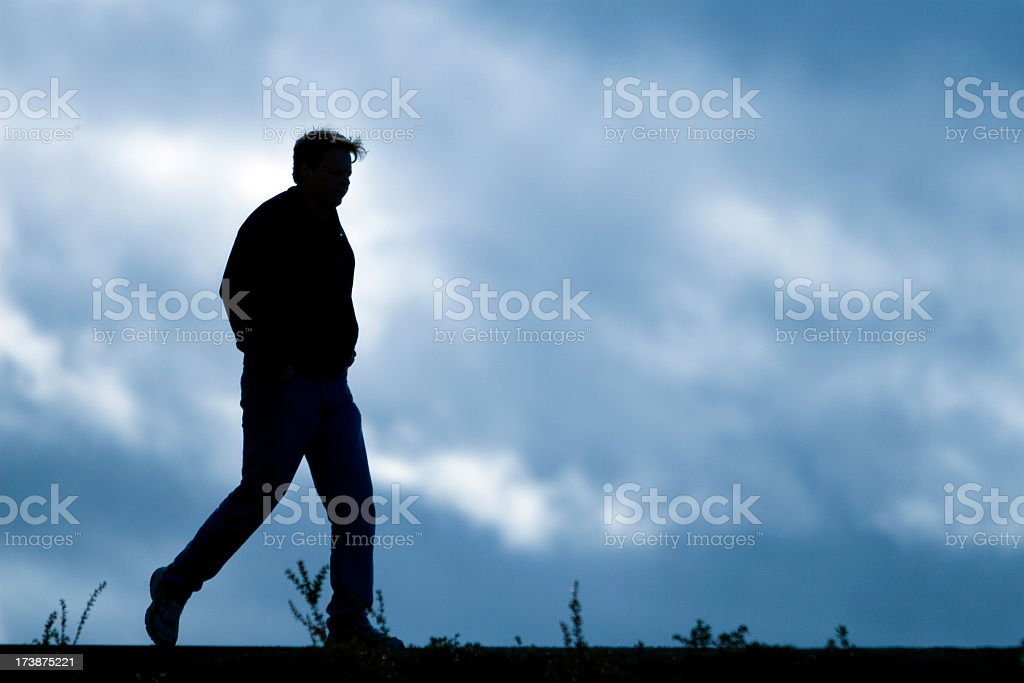 man walking alone royalty-free stock photo