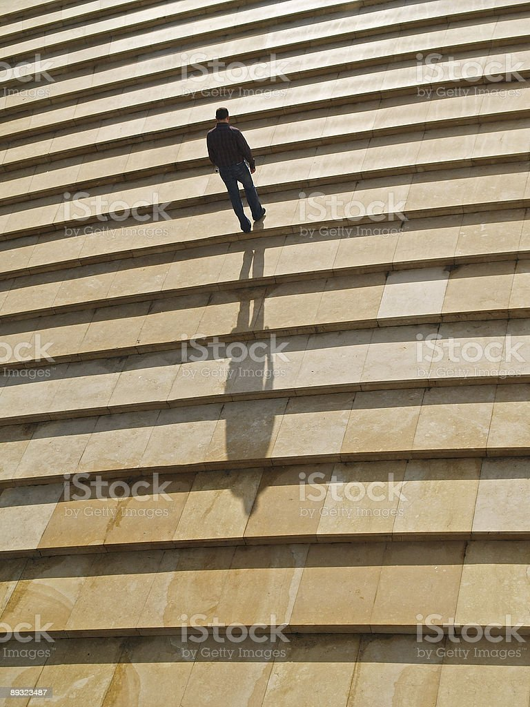 Man walking alone upstairs royalty-free stock photo