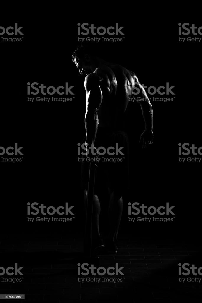 Man Walking Alone With Hammer stock photo
