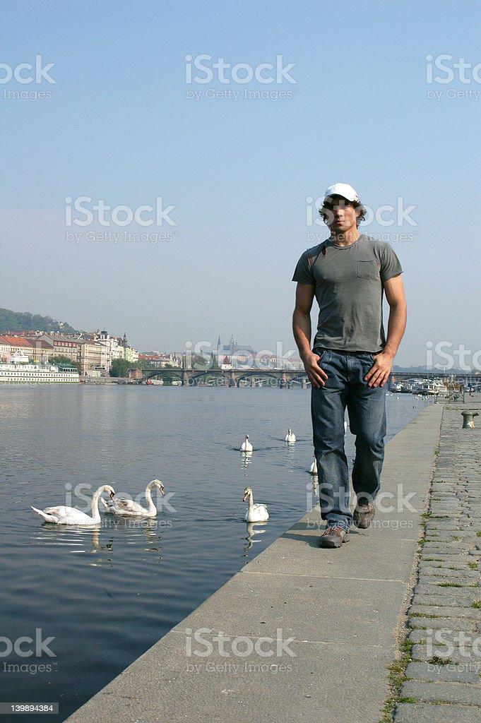 Man Walking Along the Embankment royalty-free stock photo