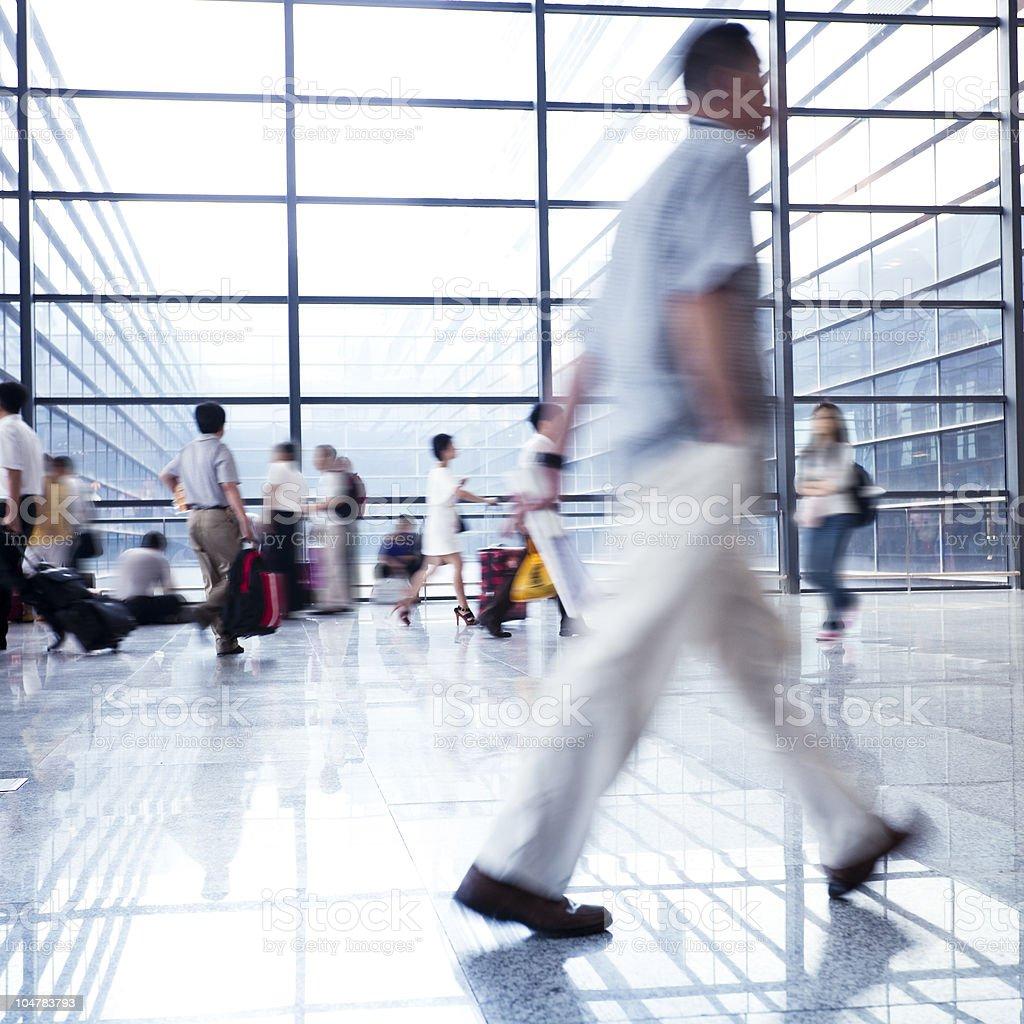 man walking at airport royalty-free stock photo