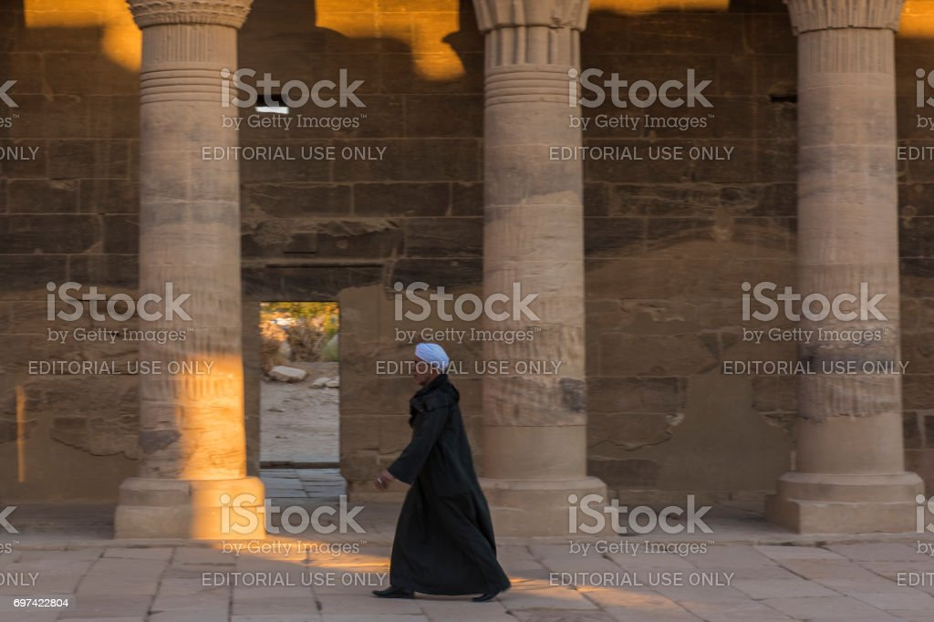 Man walking at the Temple of Philae, Aswan, Egypt. stock photo