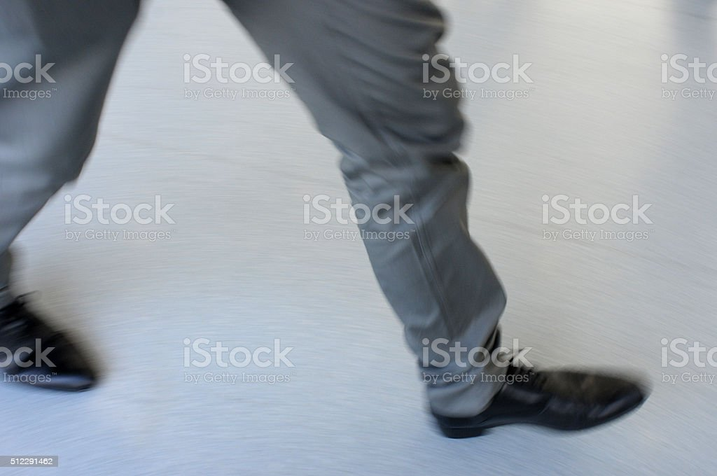 man walking fast stock photo