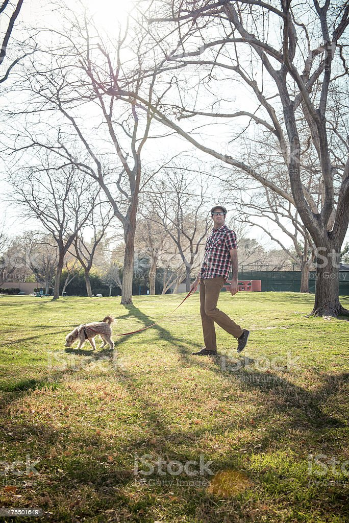 Man walking His Dog royalty-free stock photo