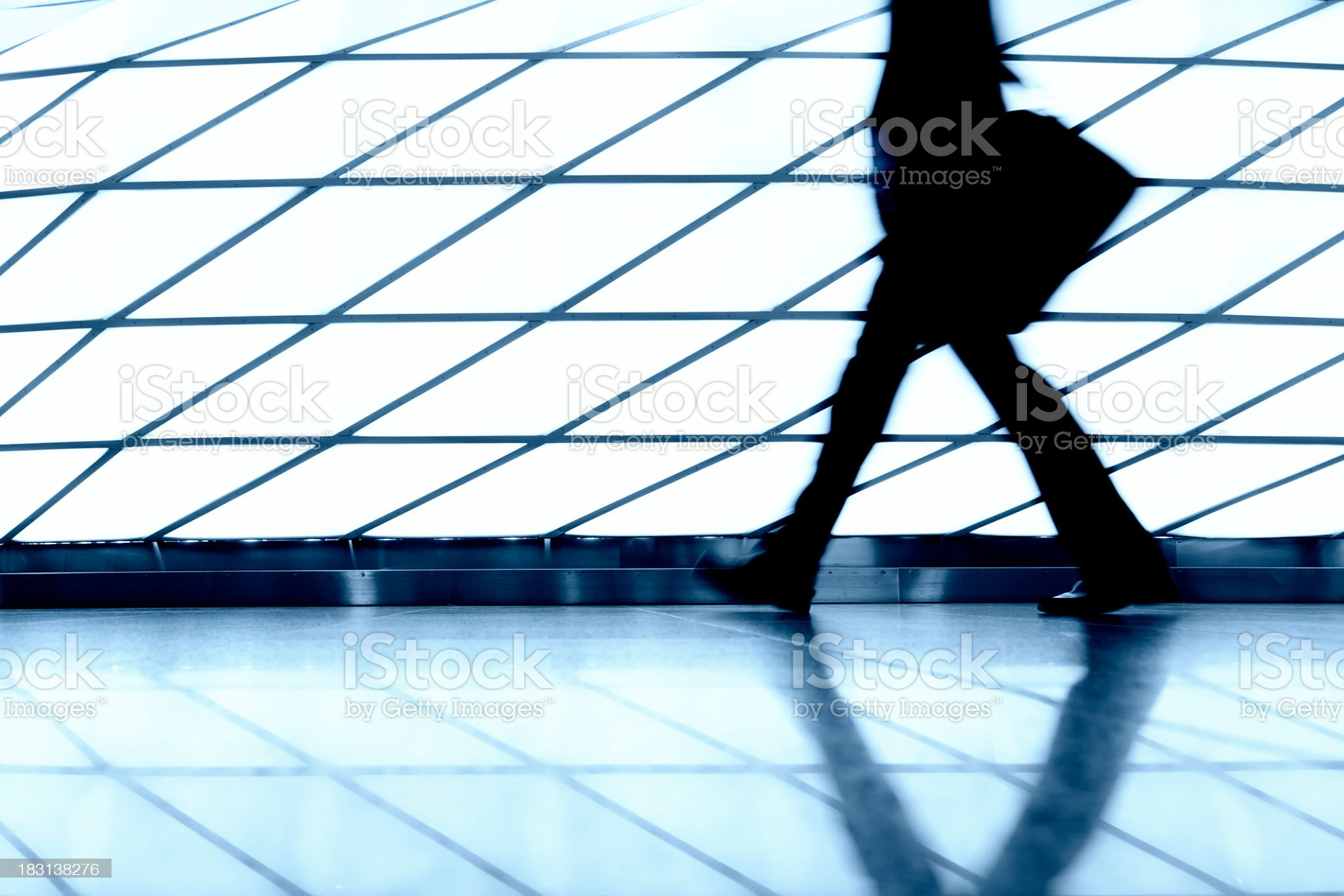 man walking in a airport corridor royalty-free stock photo