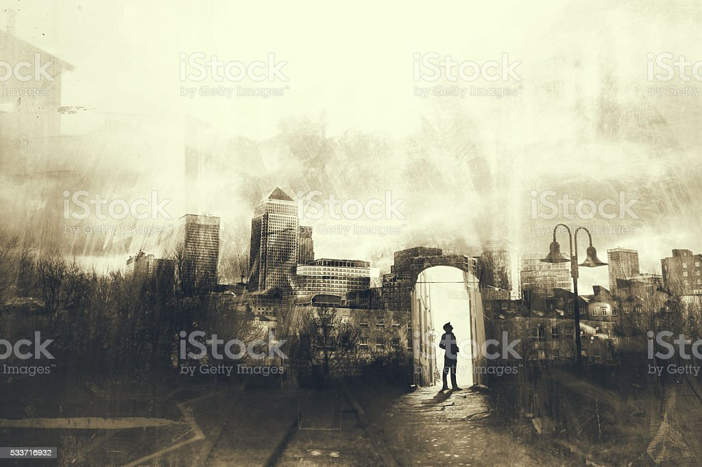 Man walking in a mystic dark city stock photo