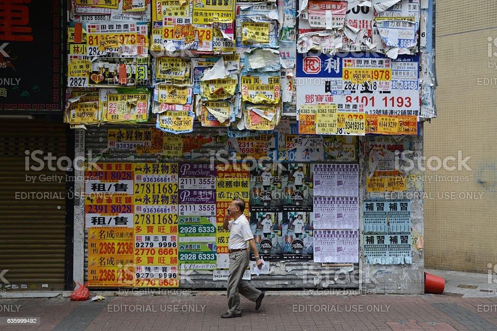 Man walking in MongKok district, Kowloon, Hong Kong stock photo