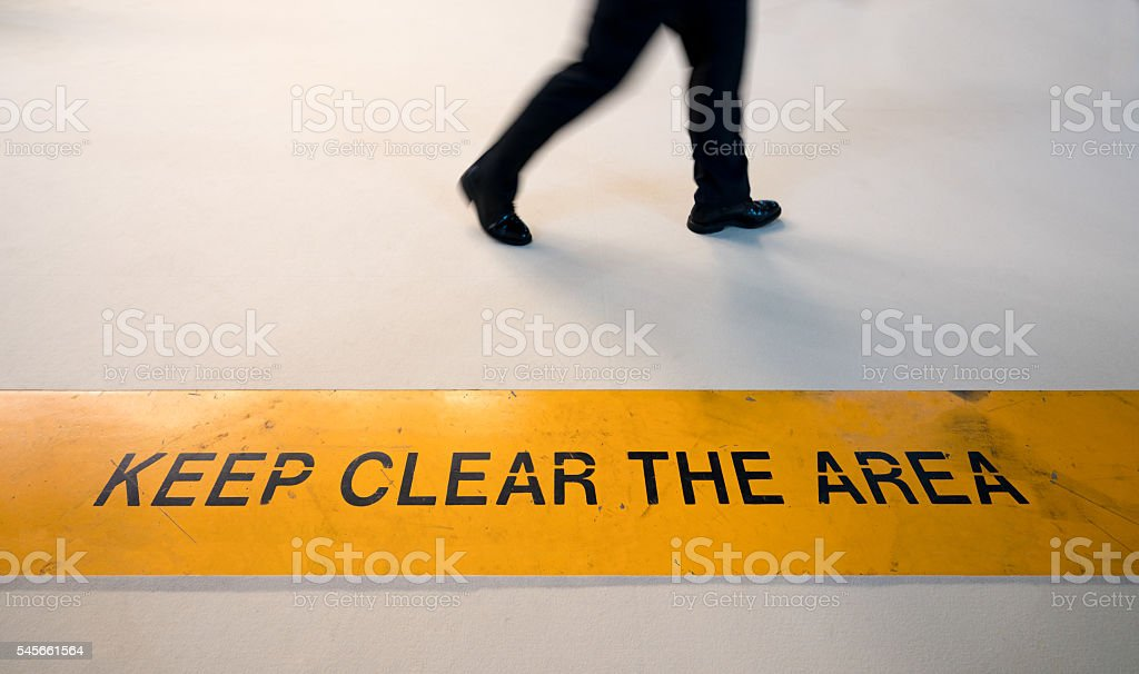 Man walking in prohibited area with motion blur, conceptual stock photo