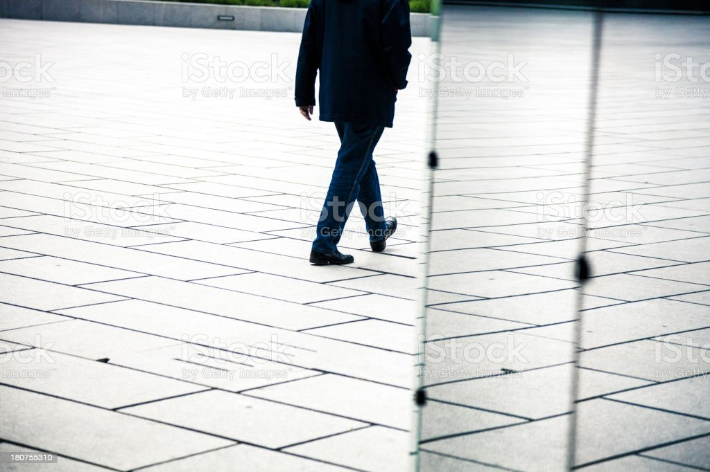Man walking in the business center stock photo