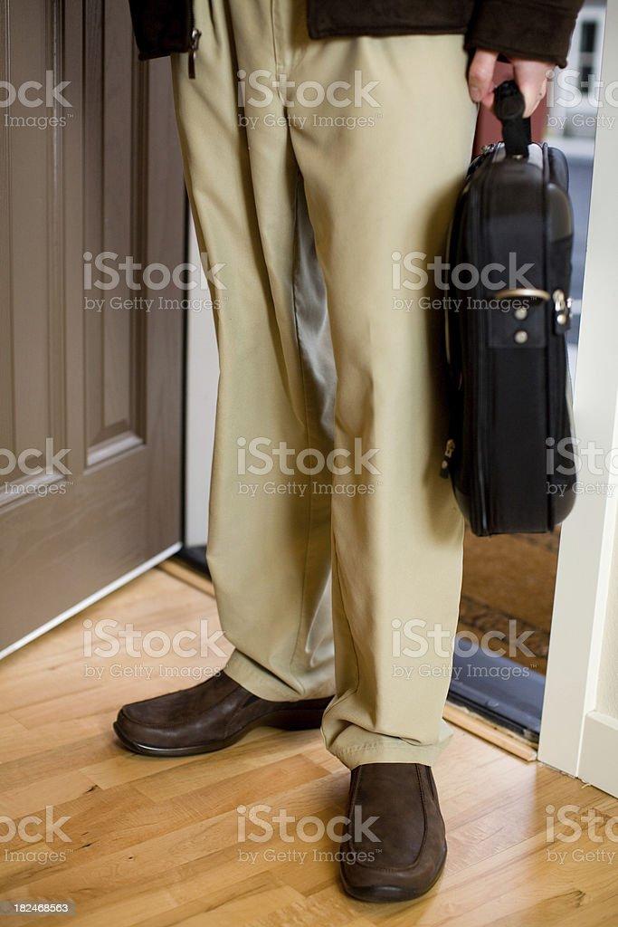 man walking in the door way stock photo