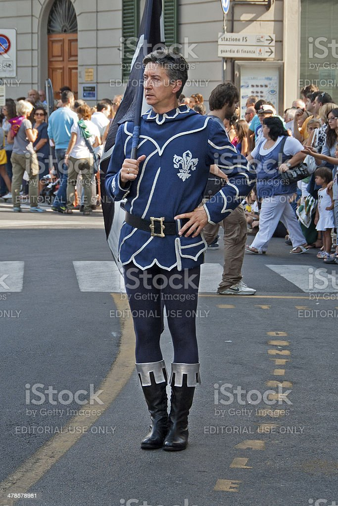 Man walking in the parade of the Palio in Arezzo royalty-free stock photo