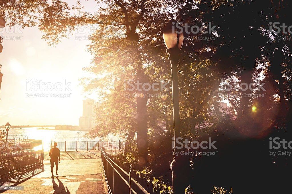 Man walking in the park stock photo