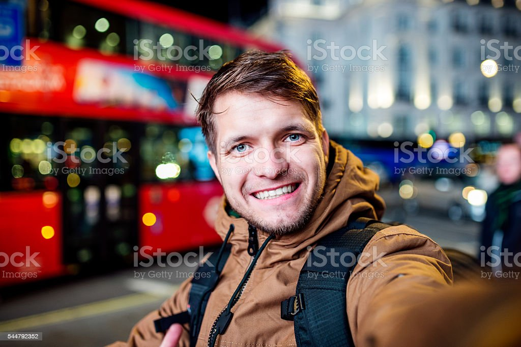 Man walking in the streets of London at night stock photo