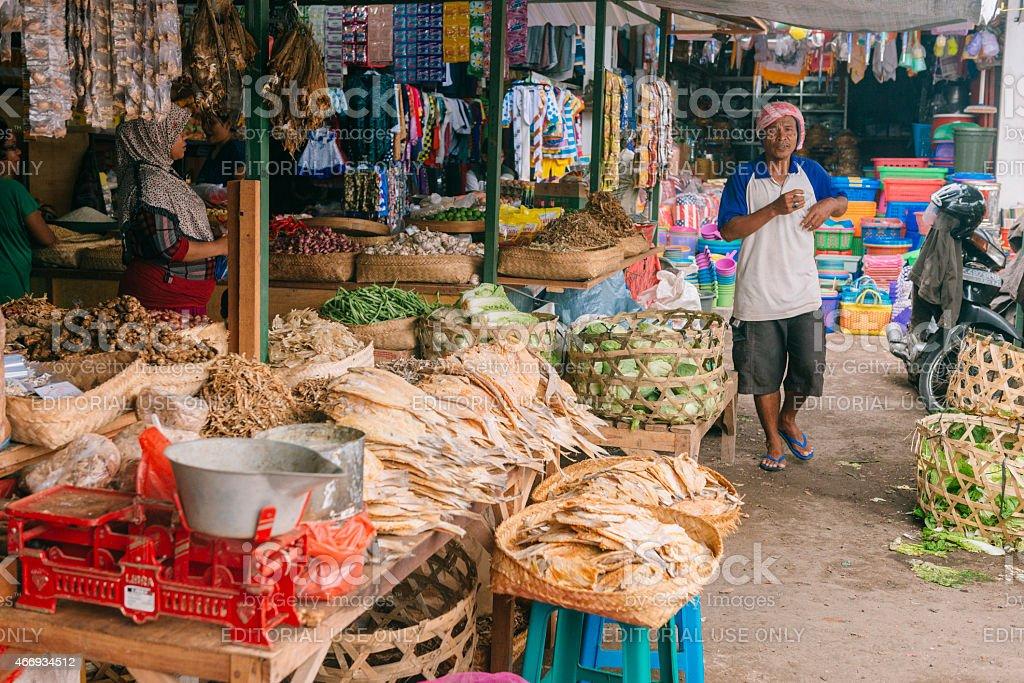 Man Walking in Traditional Indonesian Farmer's Market in Rural Bali stock photo