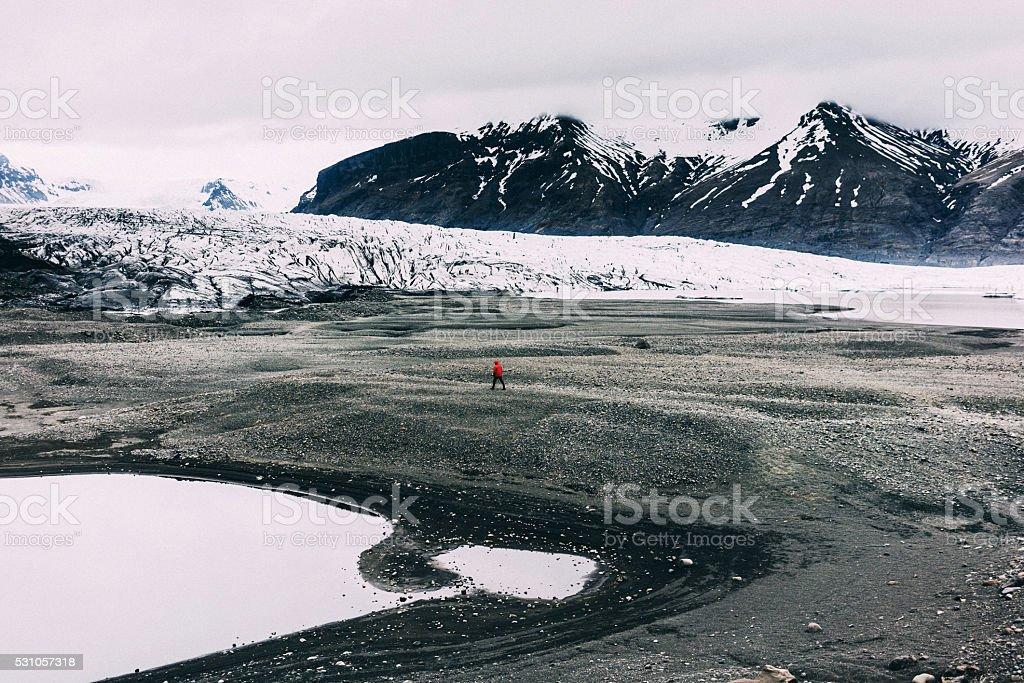 Man walking near the lake stock photo