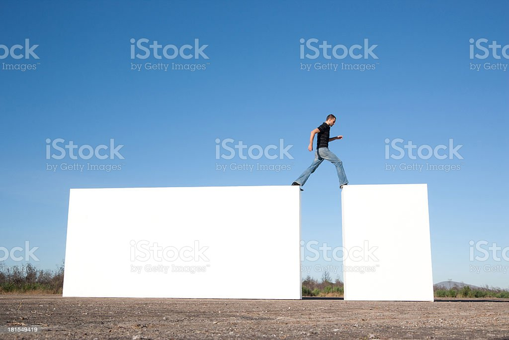 Man walking on blocks outdoors stock photo