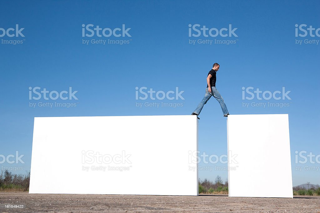 Man walking on blocks outdoors royalty-free stock photo