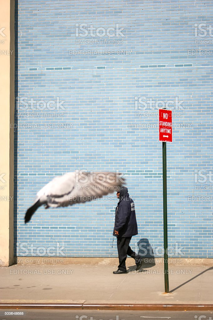 Man walking on sidewalk stock photo