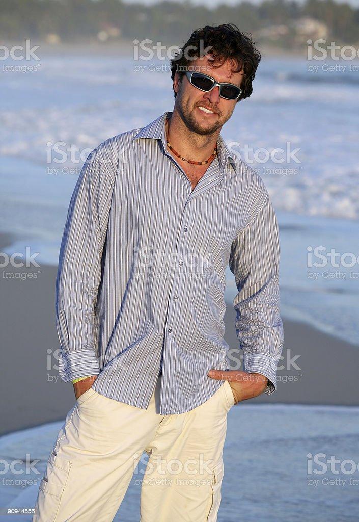 man walking on the beach royalty-free stock photo