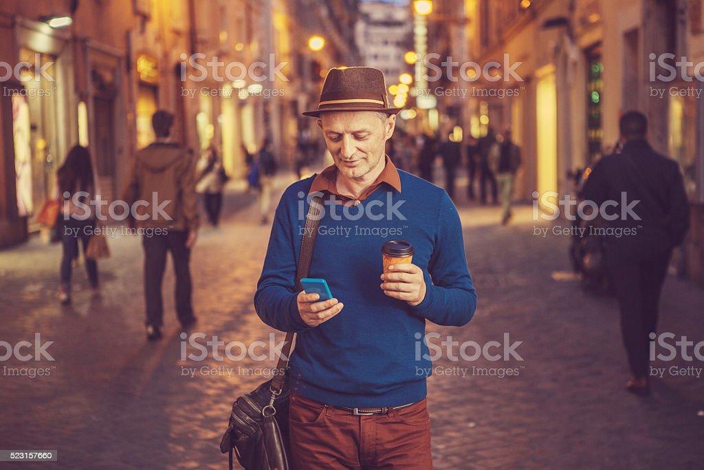 man walking on the street stock photo