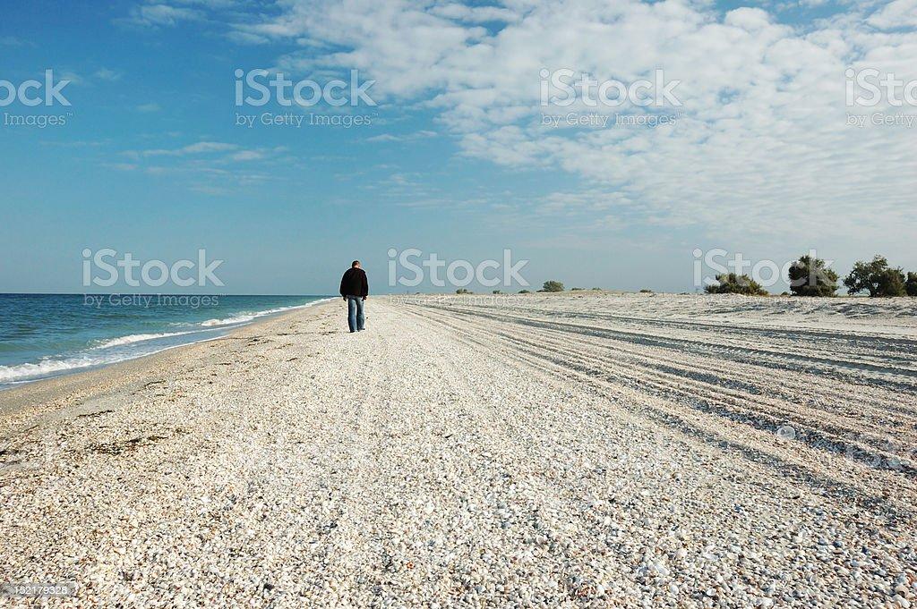Man walking on uninhabited island royalty-free stock photo