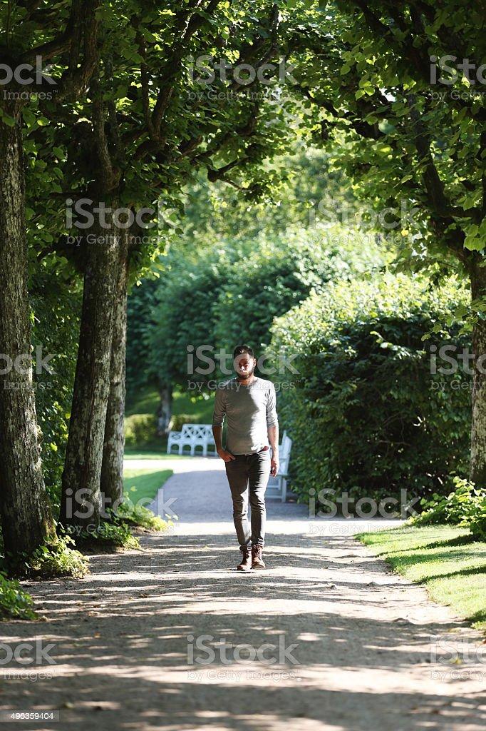 Man walking outdoors stock photo
