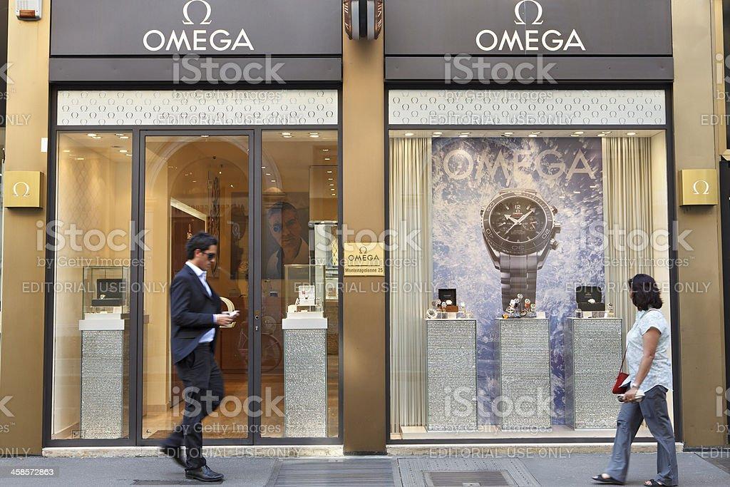 Man walking outside omega shop stock photo