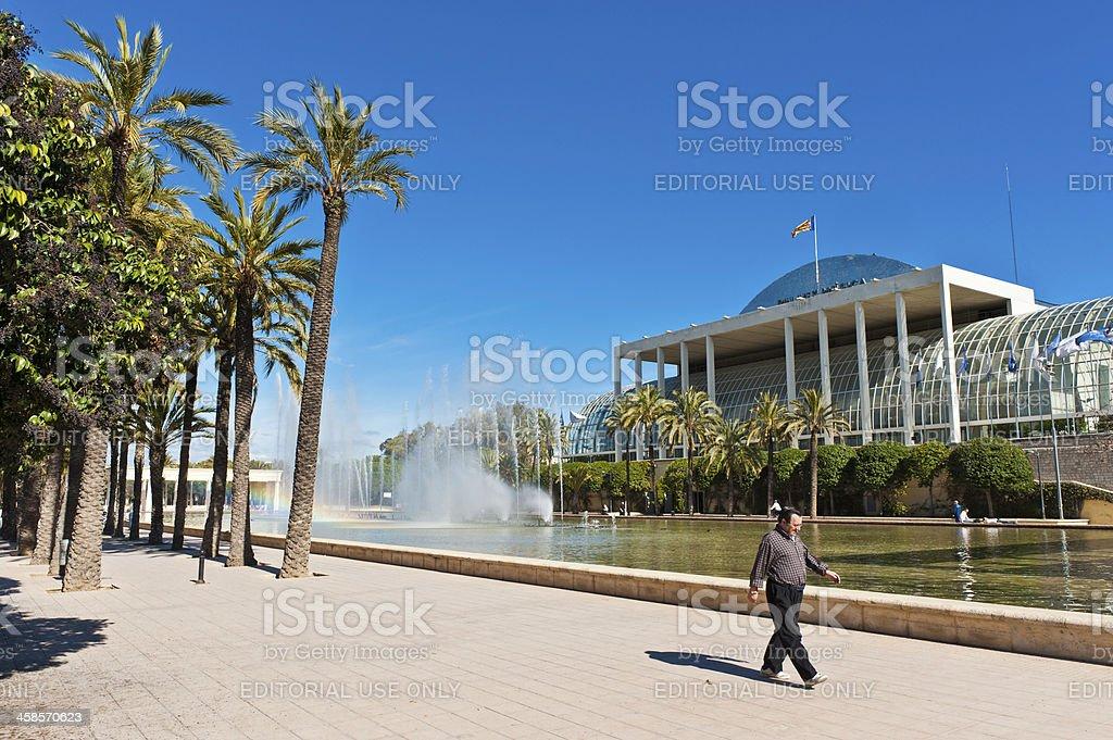 Man walking past Palau de la Musica Valencia Spain stock photo