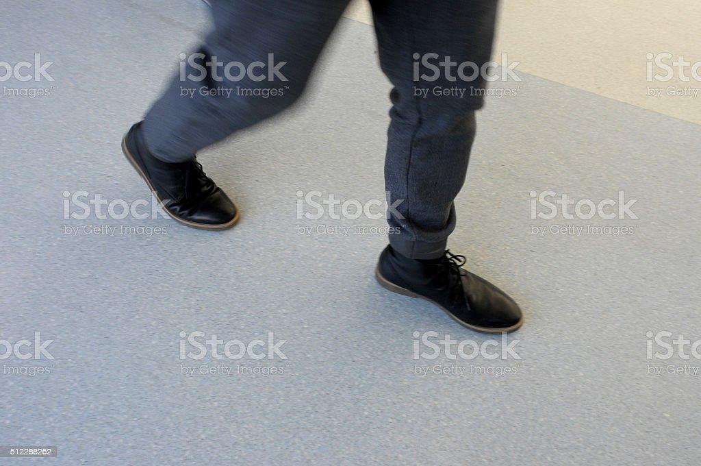 man walking quick stock photo