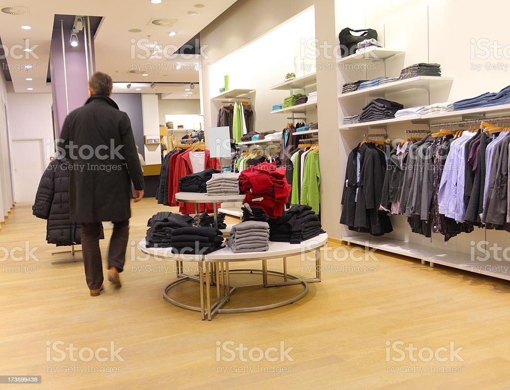 Man walking through clothing store royalty-free stock photo