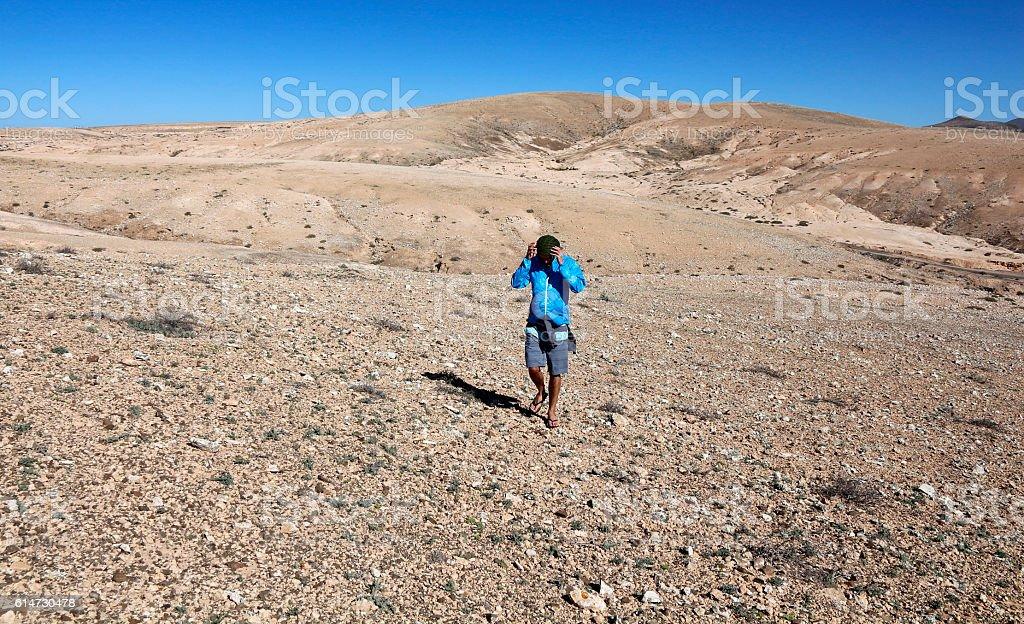 Man walking through Fuerteventura landscape stock photo
