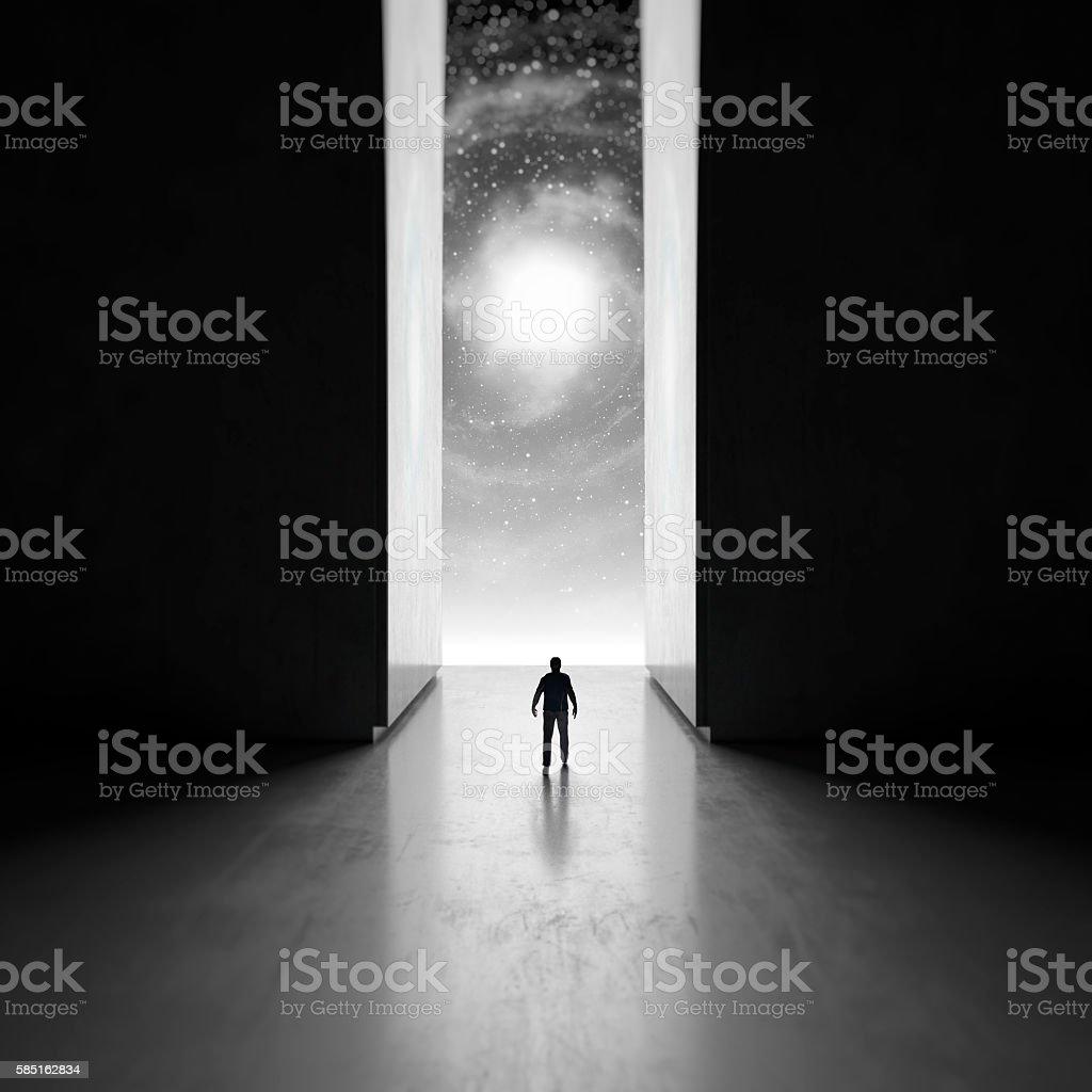 Man walking through interdimensional passage stock photo