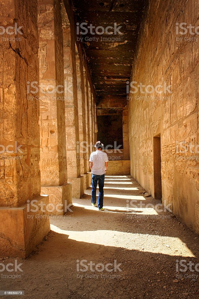 Man Walking Through Luxor Temple stock photo