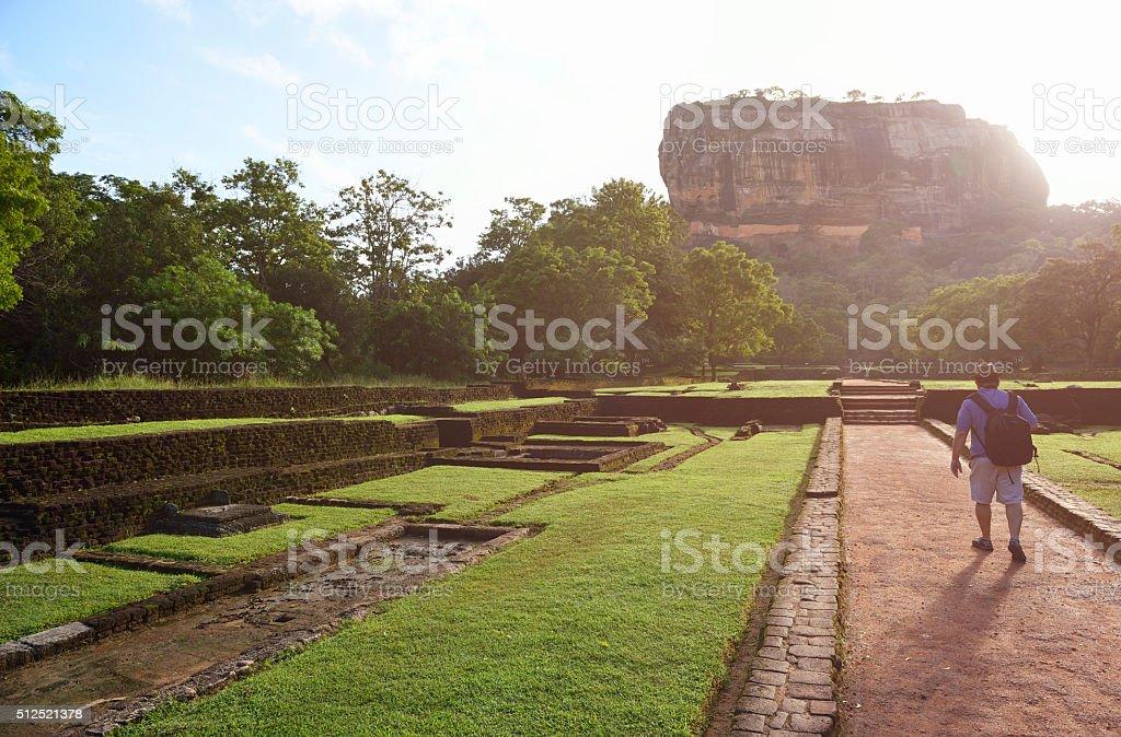 Man walking through to Sigiriya, Sri Lanka stock photo