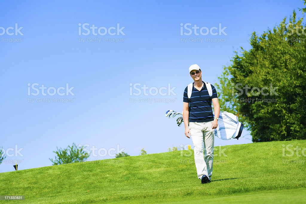 man walking to his golf ball royalty-free stock photo