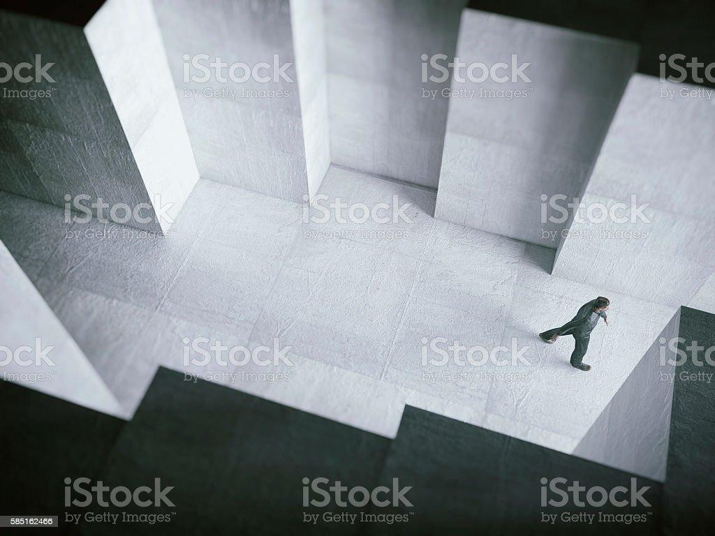 Man walking towards the light stock photo