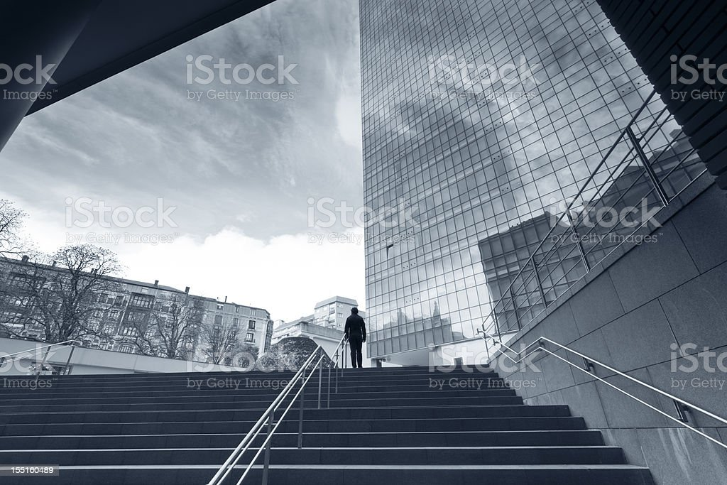 man walking up stairs royalty-free stock photo