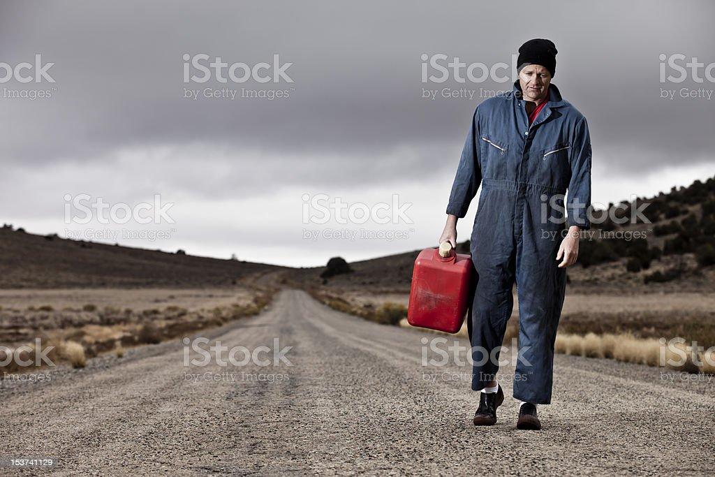 Man Walking w/ Gas Can stock photo
