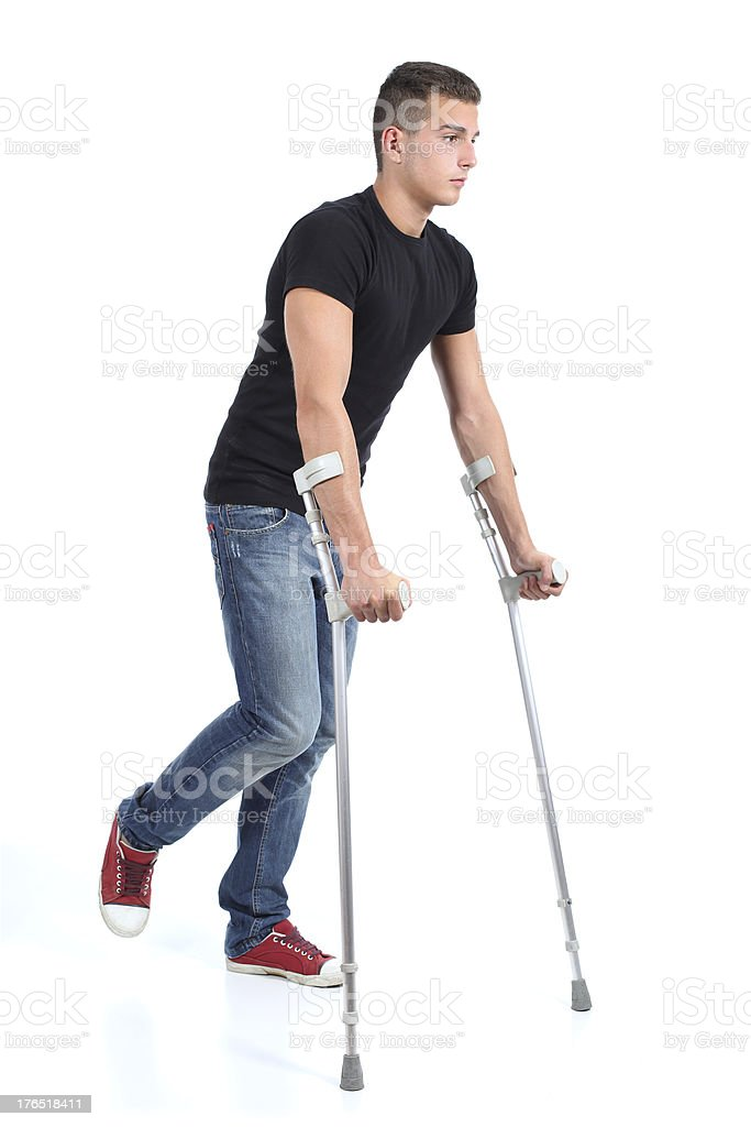 Man walking with crutches stock photo