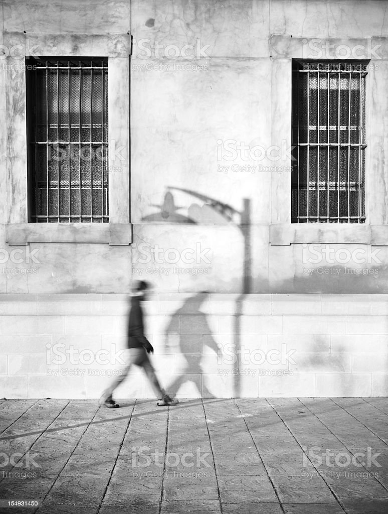 Man walking with his shadow royalty-free stock photo